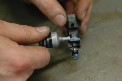 Lubricate the IAT sensor you just removed using the provided
