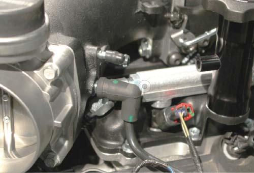 157. Plug the EVAP plastic tube on the driver side of the engine into the barb below the bypass hose on the