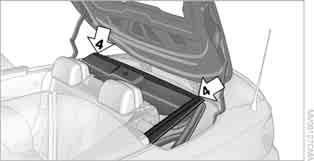 Position the rear convertible top frame upright, arrow 5, and close the convertible top box cover, arrow 6.