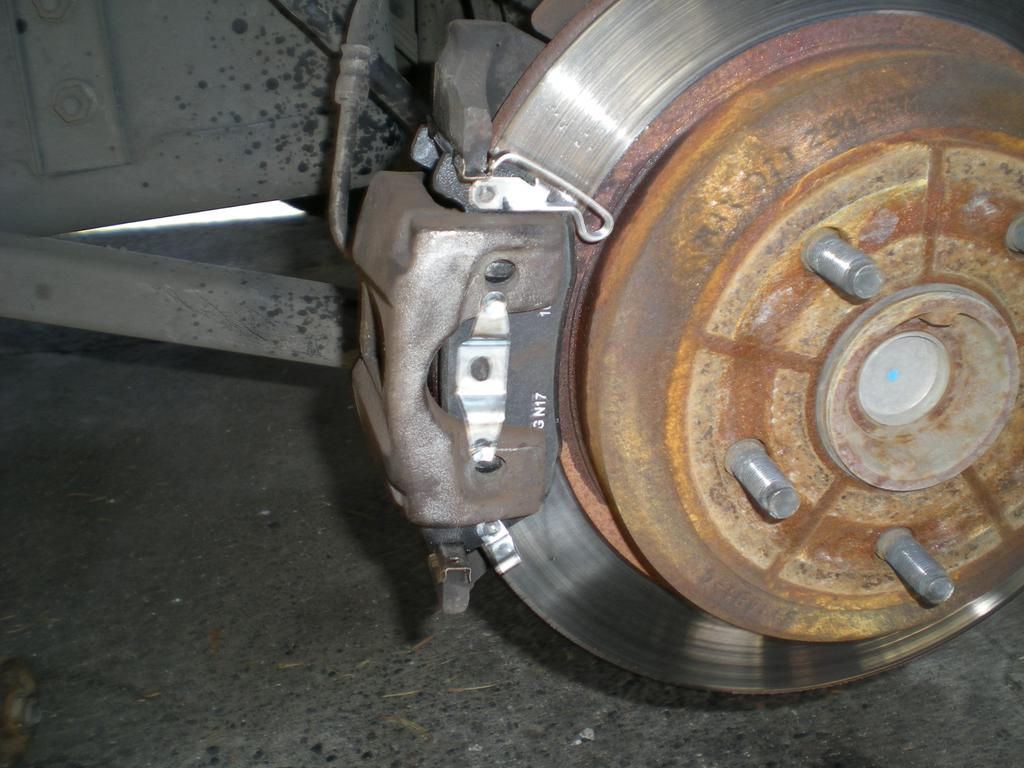 Attach the bottom of the caliper first and then tip it into place using as little force as possible.