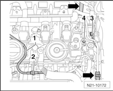 6) Unclip the vacuum line running over the cylinder head to the turbocharger at the separation