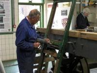 Tony Woodfield working on the mouldings on the London end of the coach Tony Woodfield