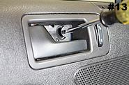 Remove the T30 screw with a Torx driver. Remove trim piece and Torx T30 screw behind the arm rest. Remove trim panel behind the door handle. 2010-2012 Mustang shown. 12.