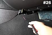 Then take the passenger side black wire from the wiring harness and insert it into the other hole.