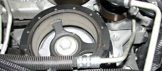 Install the supplied GM crank bolt into the crank and torque it to 37 ft-lbs, then rotate it an additional 140. 90. Slide the steering rack back into place and reconnect the electrical connector. 85.