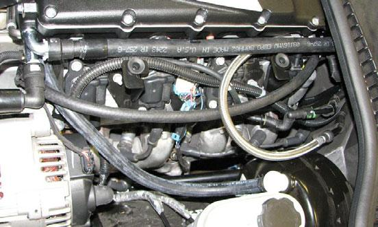NOTE: It is necessary to drain the engine coolant and remove the upper radiator hose to install the serpentine belt.