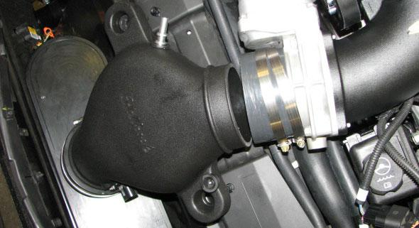 Install the two supplied grommets into the ears of the new air inlet tube on cars