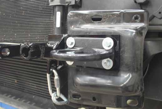 5. 2013 Models: Trim the lower radiator shroud as shown for D-Link clearance on the baseplate. Do this on both sides of the vehicle. 6.