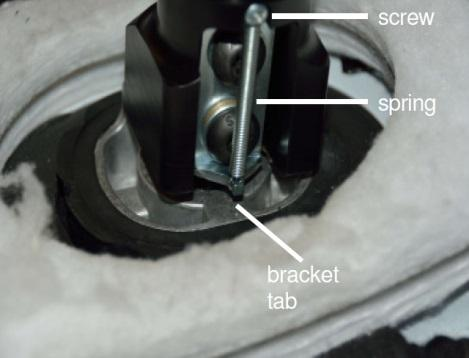 Tool: Philips Screwdriver 78. Insert the other end of the spring onto the Spring Bracket tab. 79.