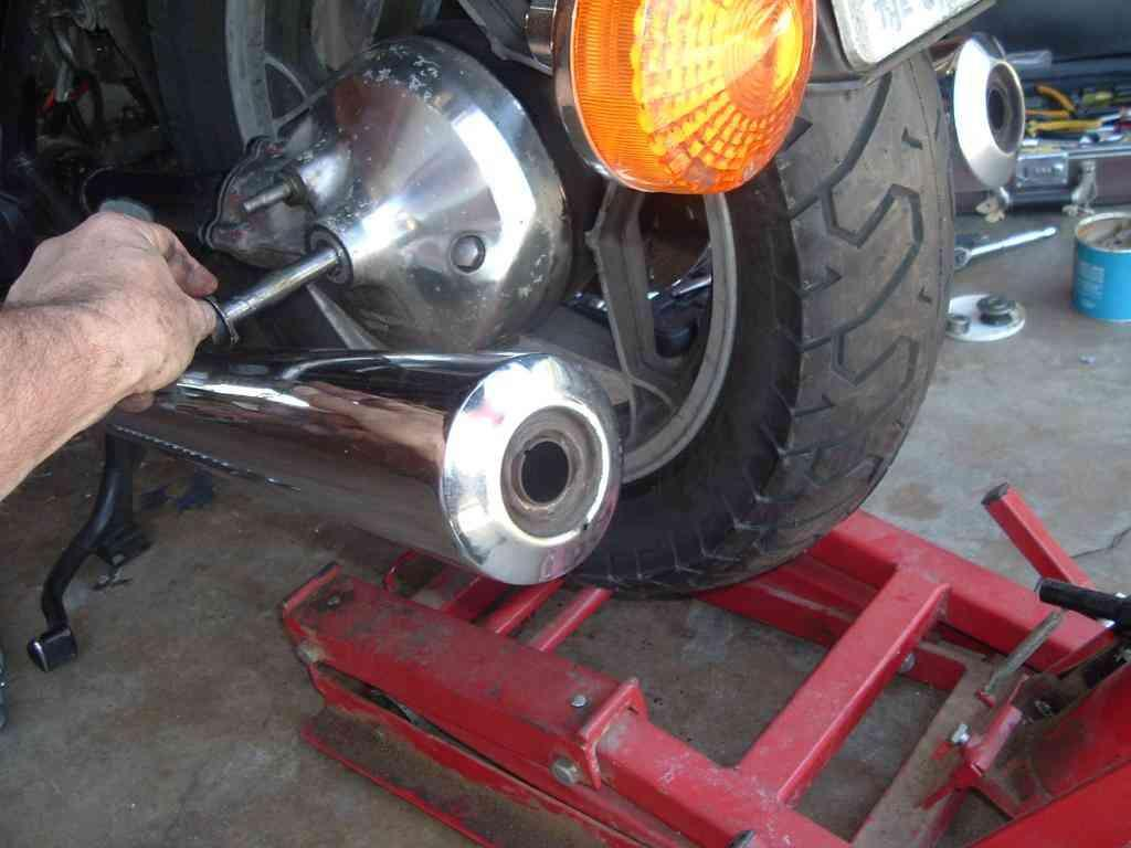 At this point, if you've put a screwdriver in the swingarm lock holes, you may wish to let it loose so that the swingarm can be manipulated more easily while mounting the wheel.