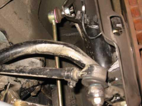 Make sure that the front suspension is easily loaded (both sides evenly compressed). If not, it will be difficult to slide the connecting bolts through the sway bar end holes.