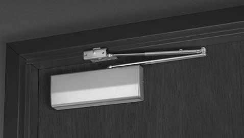Closer is mounted on the pull side, with the arm almost perpendicular to the face of the door.