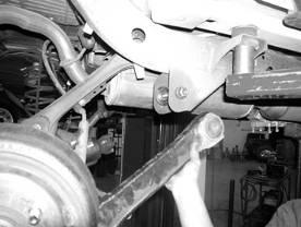 SEE REAR SUSPENSION INSTRUCTIONS: 36. Jack up the rear end of the vehicle and support the frame rails with jack stands just in front of the rear bumper.