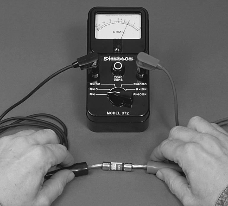Connect the ohmmeter leads as shown above. Coil with Ohmmeter 1. Set R x 1,000. 2. Connect leads as shown. 3.