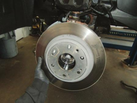 Remove brake caliper and