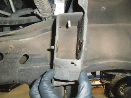 Loosen upper control arm