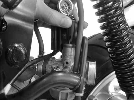 Install the throttle valve by aligning the groove in the throttle valve with the throttle stop screw.