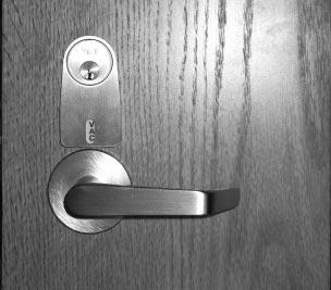 When specifying option IND, the lockset will be provided with an indicator that shows the room is either occupied (OCC) when deadbolt is thrown or vacant (VAC) when deadbolt