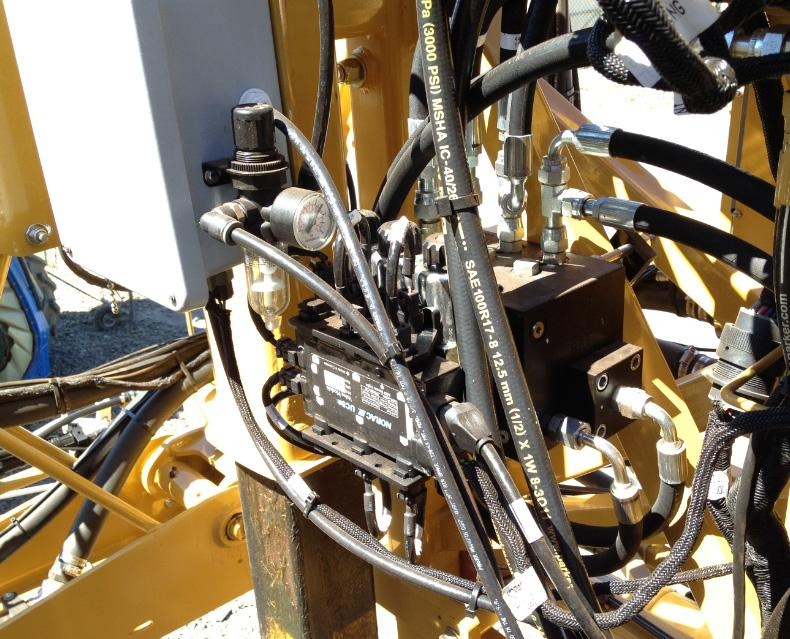 9.2 Valve Block Mounting 1. A suitable mounting location for the valve block on the Rogator is illustrated in Figure 21. 2. Insert the threaded rod into the block and use a hex nut to hold the rod.