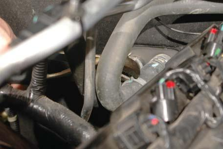 Remove the stock center-most heater hose from the firewall hose barb on the passenger side of the engine