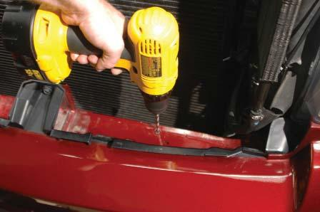 Pull the hoses off the hose barbs of the power steering cooler, and pull the cooler off the plastic tabs