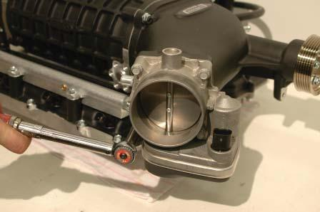88. Install the throttle body on the new supercharger intake with the motor pointing down.