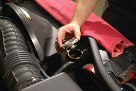 4. Slowly remove the gas cap to release fuel system pressure. 5.