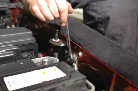 Remove the ground bolt on the engine compartment driver side fender wall by the negative battery