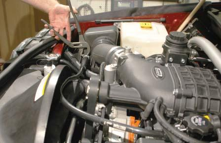184. Remove the air box end of the hose from the OEM PCV plastic line and
