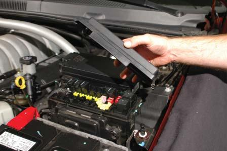 8. Open the cover of the forward fuse center just behind the battery on the driver side of the