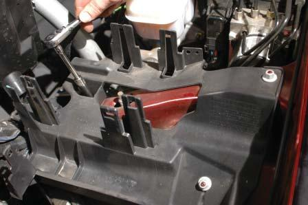 On the driver side, the mounting fl ange will hit the bottom of the brake cylinder.