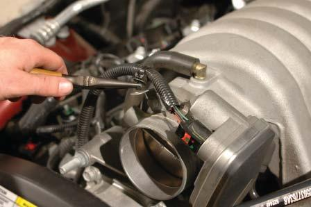 Disconnect the eight fuel injectors by pulling up on the red locking clip, then squeezing the