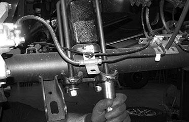 Locate the factory brake line mount on the driver side of the frame.