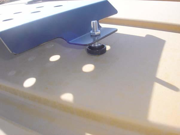 Tighten the bolts with a 10mm socket and ratchet. Figure 2-5 Attach the Roof Rail Mounting Bracket (Left Side Shown) Roof Rail Mounting Bracket 9.