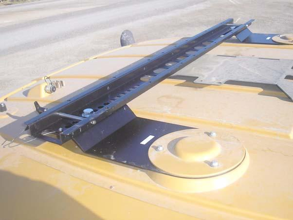 Challenger MT-600C Installation Procedure 12. Place the Roof Rail on top of the Roof Rail mounting brackets and center it over the cab.