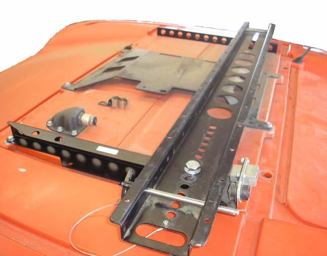 Massey Ferguson MF-8600 and AGCO DT-200B Installation Procedure 6. Install the Roof Rail over the rear bracket holes. See Figure 2-15. Note: Ensure the Roof Rail is aligned perpendicular to the roof.