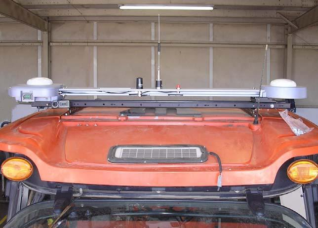 Massey Ferguson MF-8600 and AGCO DT-200B Installation Procedure 10. Place the Roof Module on the Roof Rail. See Figure 2-18.