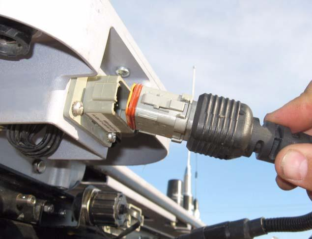 Roof Module Connection 1. Connect the Main Harness from the Roof Module to the existing cab roof connector. See Figure 4-2. 2.