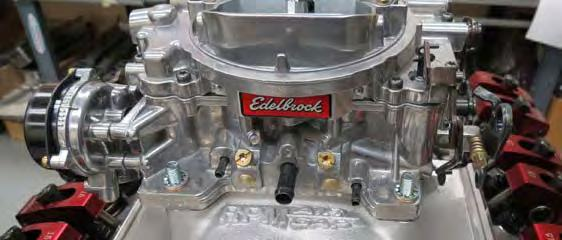 Install the carb gasket and the carb onto the manifold so that the Edelbrock logo on the
