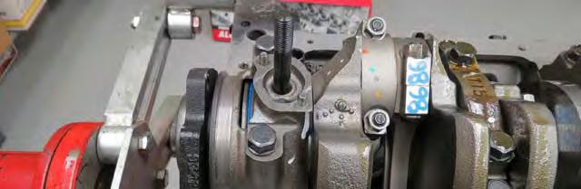bag #1. The timing pointer should be installed on the left side of the engine as shown below. Torque bolts to 5 ft-lbs.
