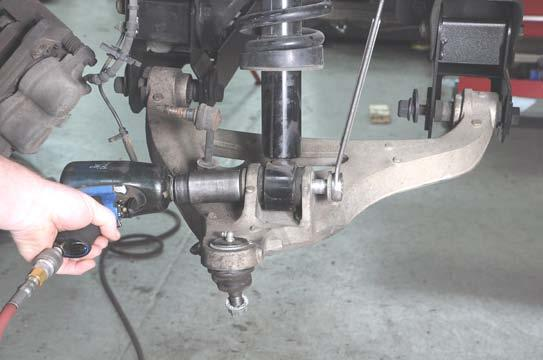 33. Install the strut in the mount on the lower control arm using the factory hardware.