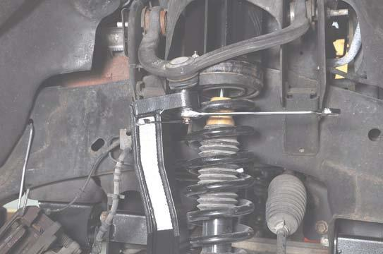 Tighten the lower ball joint nut using a 22mm wrench and