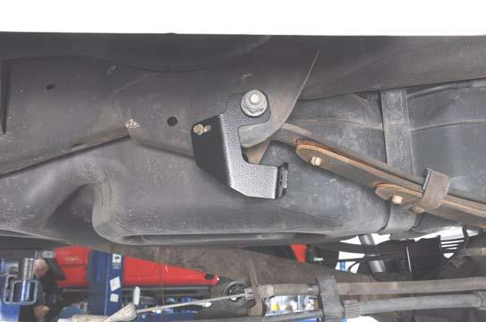 Using a 0mm wrench, 24mm wrench, and 27mm socket, remove the emergency brake