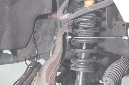 0. Using a 22mm wrench, loosen the upper ball joint nut.