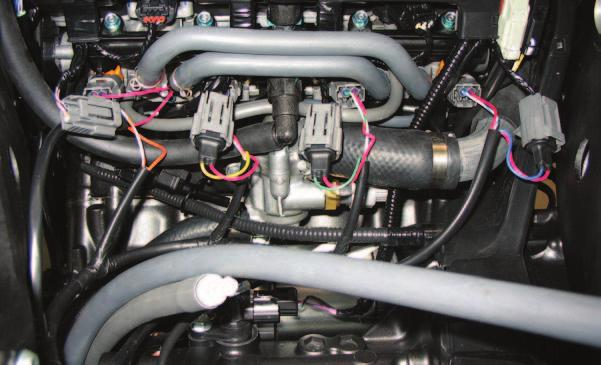 FIG. D 9 Plug the PCV wiring harness in-line of the stock injectors and
