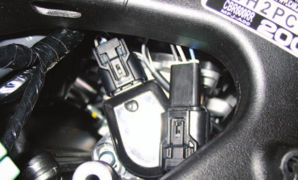 FIG. G 12 Plug the BLACK connectors from the PCV in-line of the stock TPS and wiring harness (Fig. G). FIG. H 13 Install the PCV in the tail section of the motorcycle.