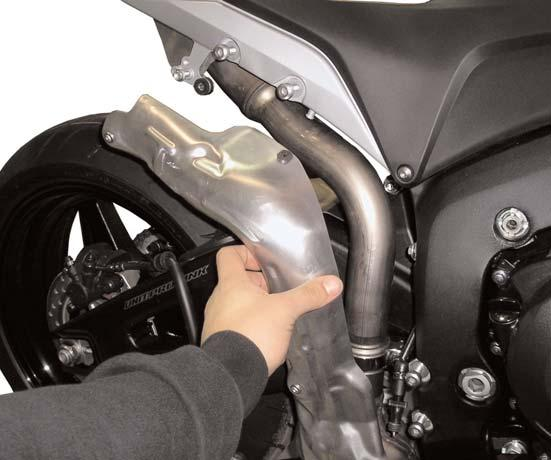 Do not tighten the clamp at this time. Make sure the t-bolt clamp does not hit the swingarm when mounted.
