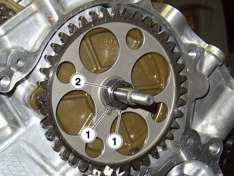 9100843) to tighten primary gear nut.