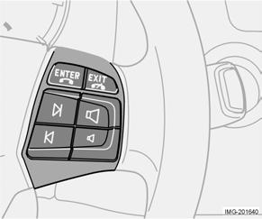 Instruments and controls Steering wheel keypad (option) The four buttons at the bottom of the steering wheel keypad control the radio and the telephone.
