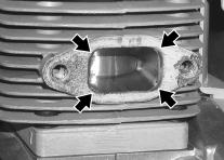 Do not scratch the cylinder or piston when cleaning the exhaust port. Do not allow carbon particles to enter the cylinder. 4. Inspect heat shield, and replace if damaged. 5.